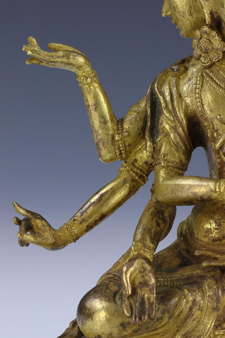 A CHINESE GILT BRONZE FIGURE OF GUANYIN WITH THREE FACE - 4