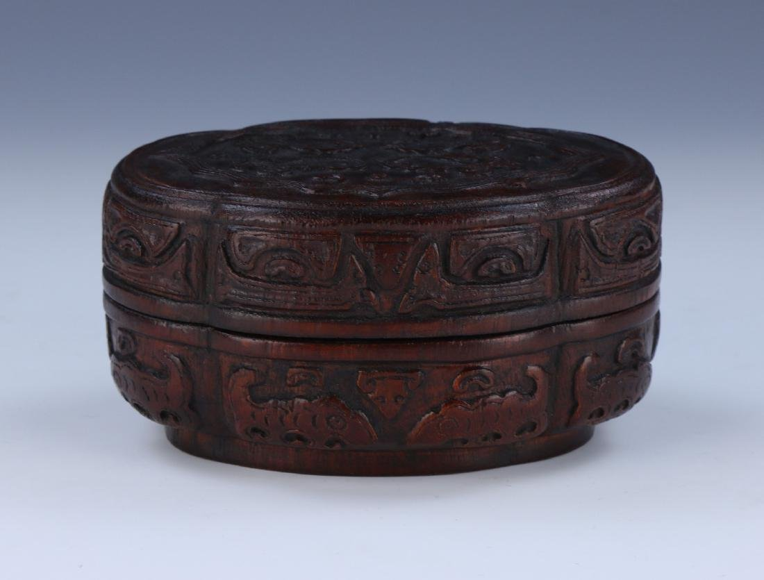 A CHINESE ANTIQUE AGARWOOD CARVED LIDDED TRINKET BOX