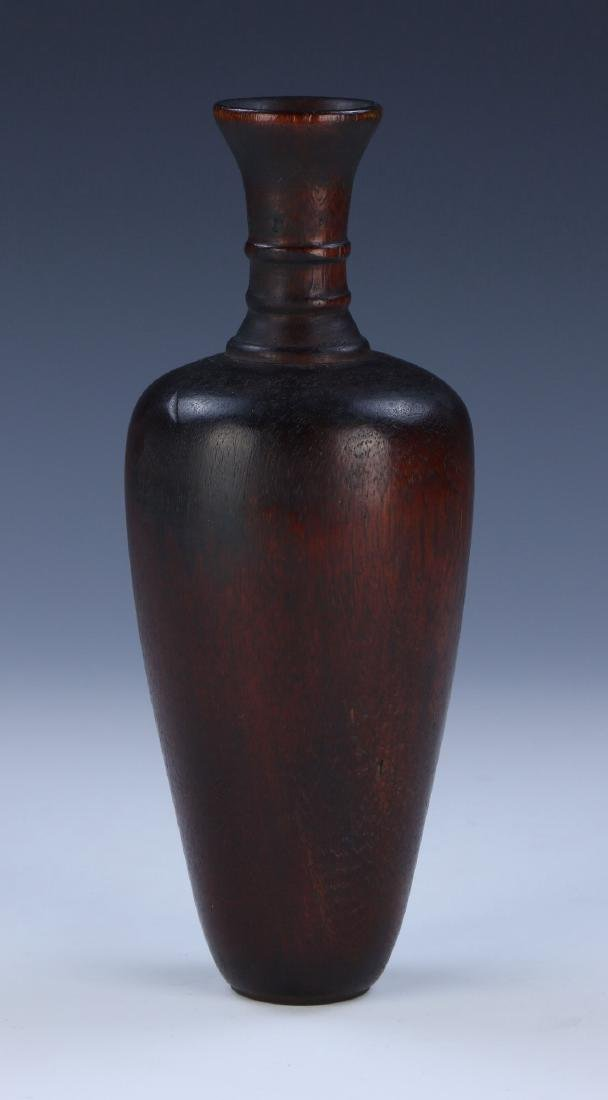 A CHINESE ANTIQUE AGARWOOD CARVED VASE