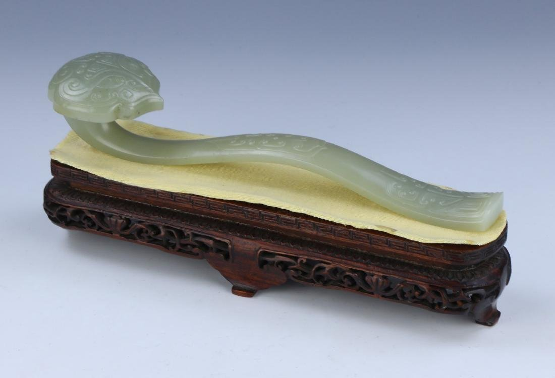 A CHINESE JADE RUYI SCEPTRE WITH WOOD STAND