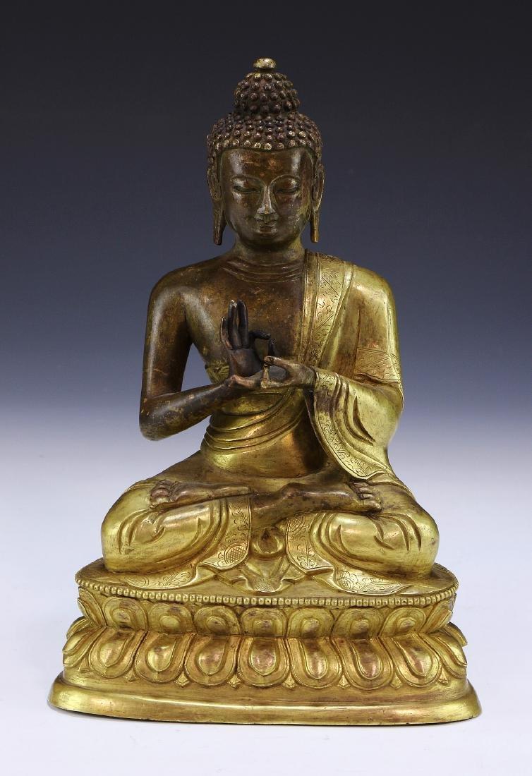A SINO TIBETAN GILT-BRONZE FIGURE OF BUDDHA SHAKYAMUNI