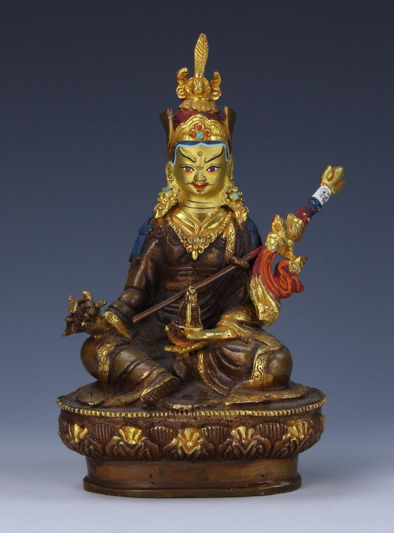 A CHINESE GILT BRONZE FIGURE