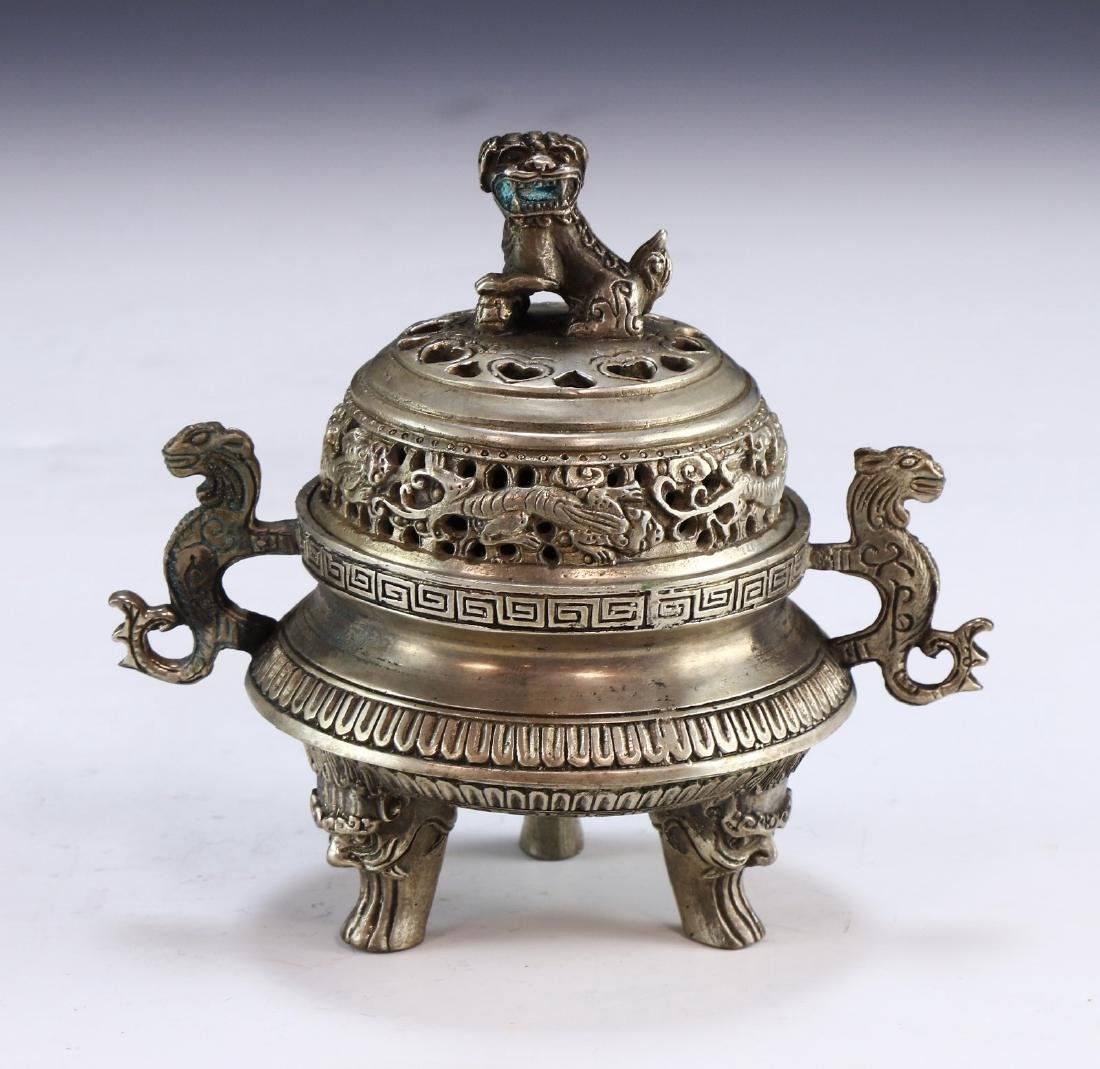 A CHINESE WHITE BRASS LIDDED TRIPOD CENSER