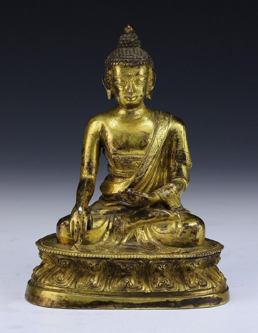 A Gilt Bronze Figure Of Shakyamuni
