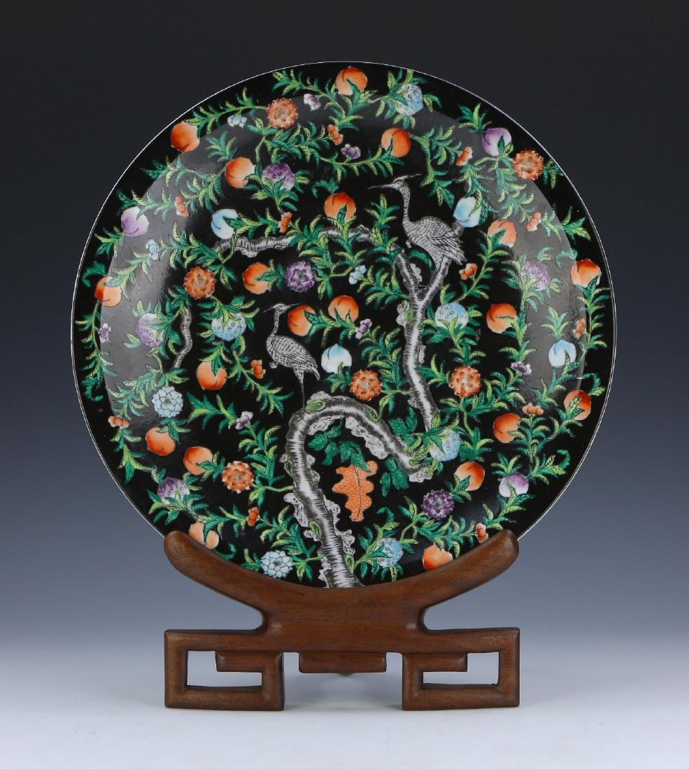 A CHINESE FAMILLE ROSE PORCELAIN PLATE WITH STAND