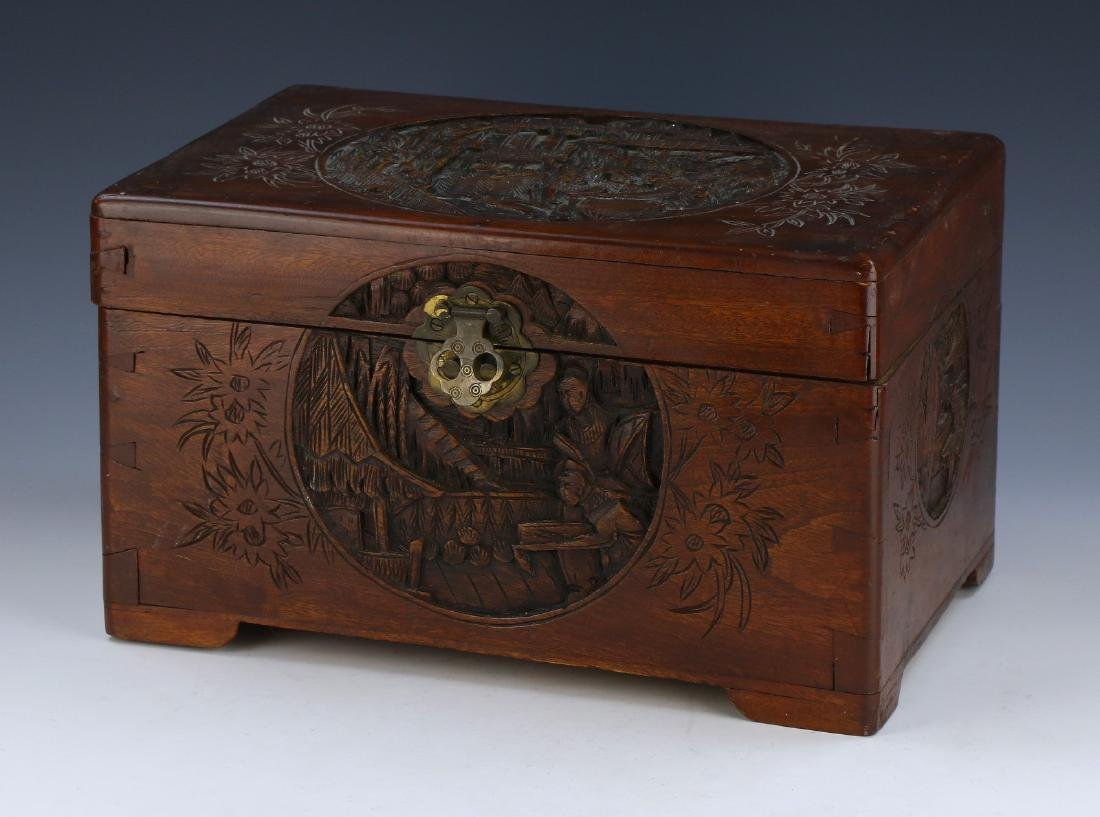 A CHINESE CAMPHOR WOOD CARVED BOX