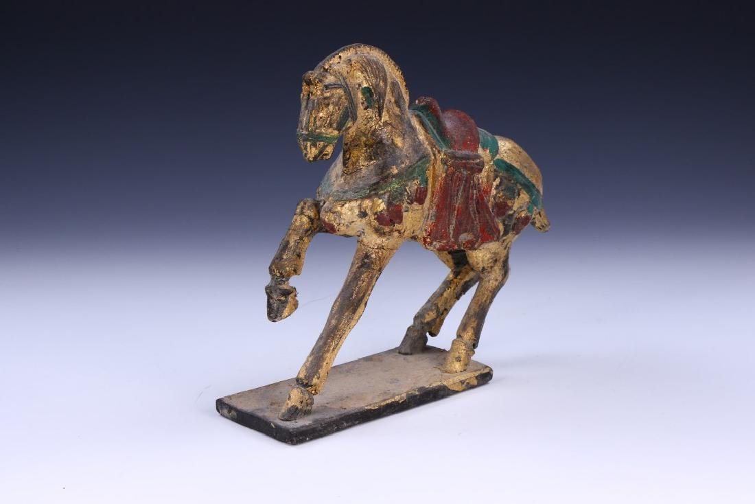 A CHINESE POLYCHROME WOOD HORSE