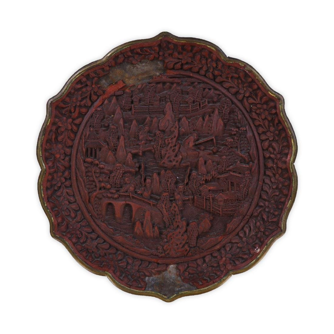A CHINESE RED CINNABAR LACQUER PLATE