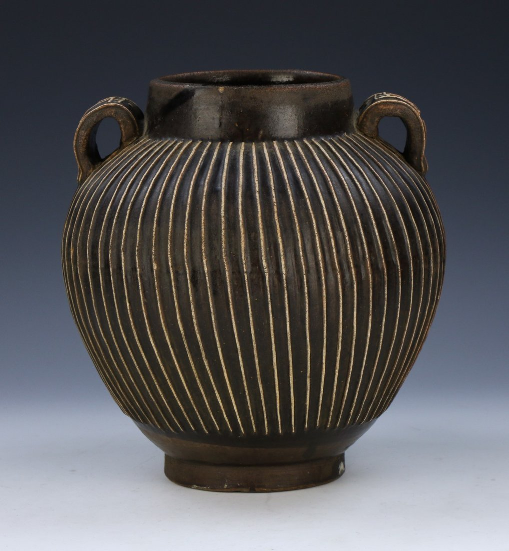 A CHINESE BLACK GLAZED HANDLED PORCELAIN JAR