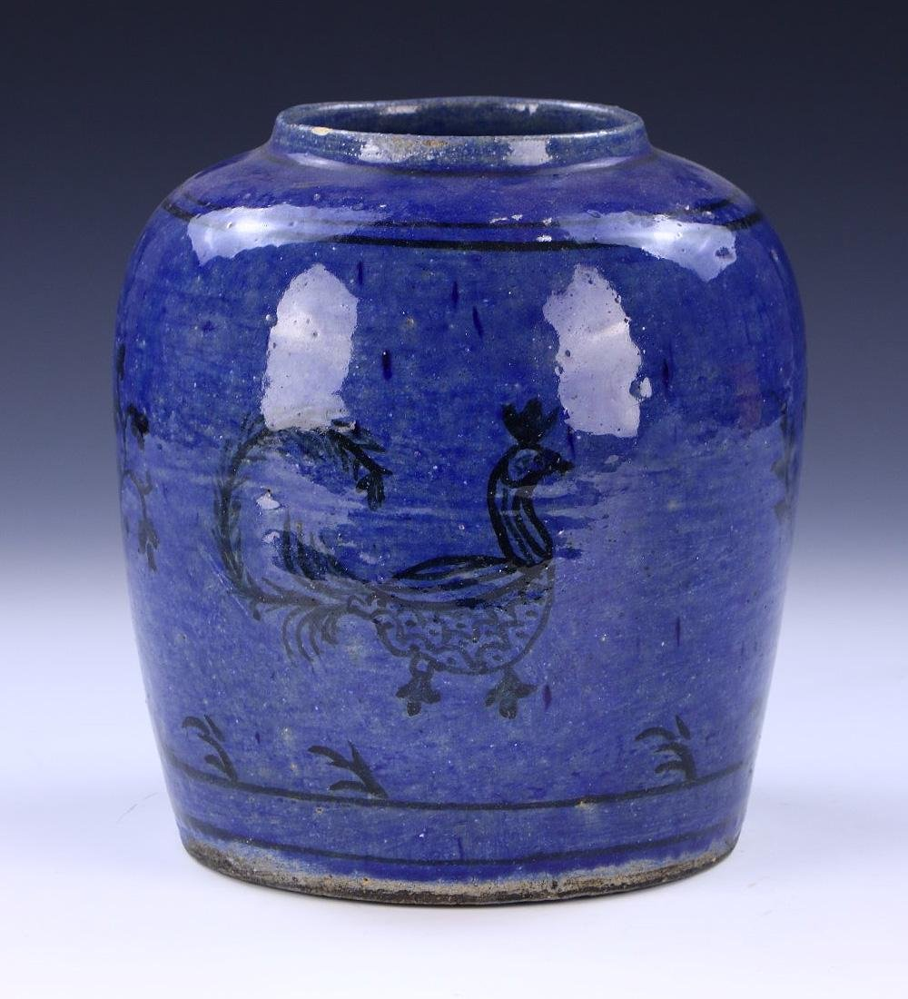 A MIDDLE EAST BLUE GLAZED PORCELAIN JAR