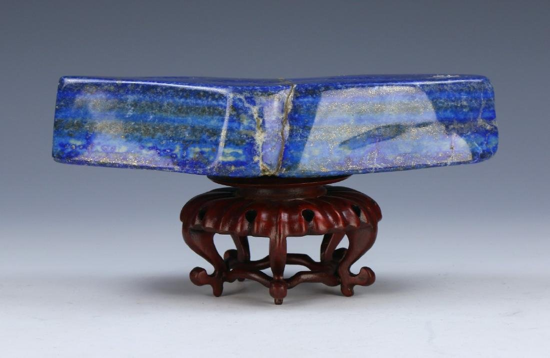 A LAPIS BLUE ROCK & WOODEN STAND - 2