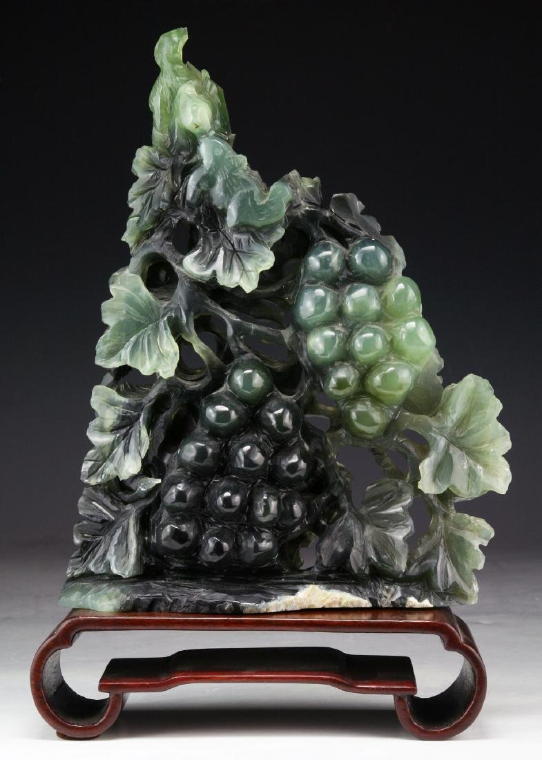A CHINESE JADE CARVING OF GRAPES AND SQUIRRELS