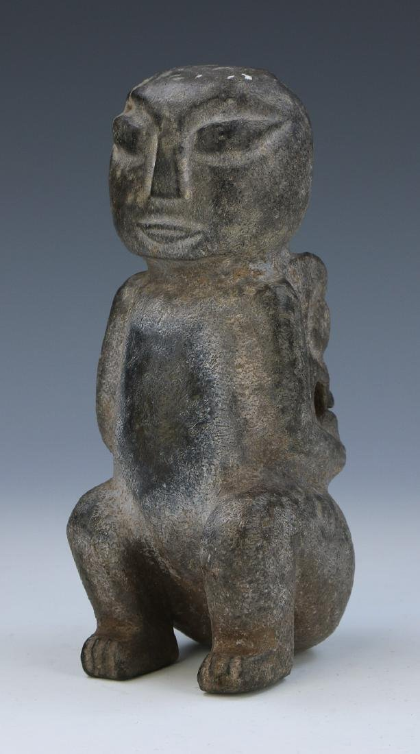 A CHINESE ARCHAIC JADE CELESTIAL FIGURE