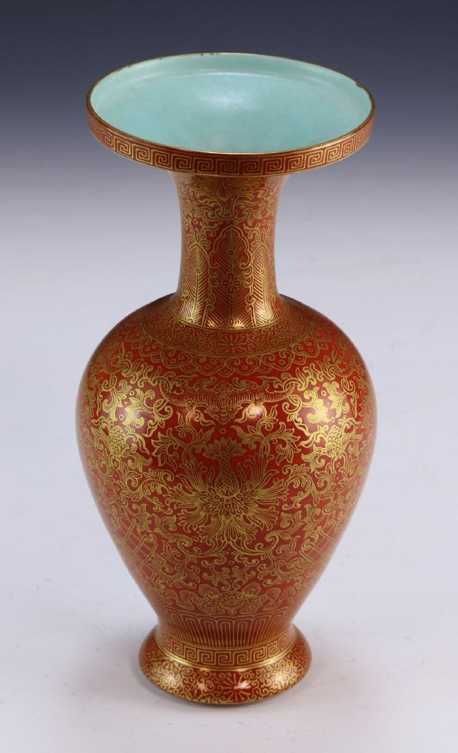 A CHINESE GILT & IRON RED GLAZED PORCELAIN VASE