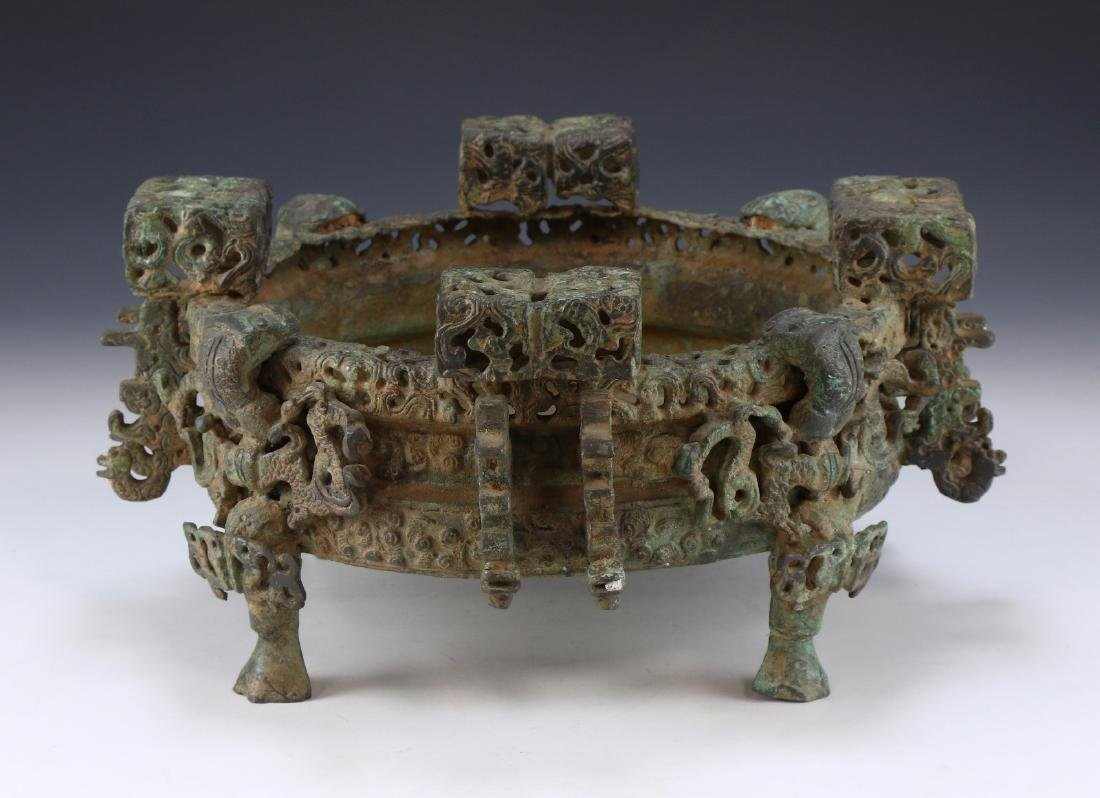 A CHINESE ARCHAIC BRONZE TRIPOD CENSER