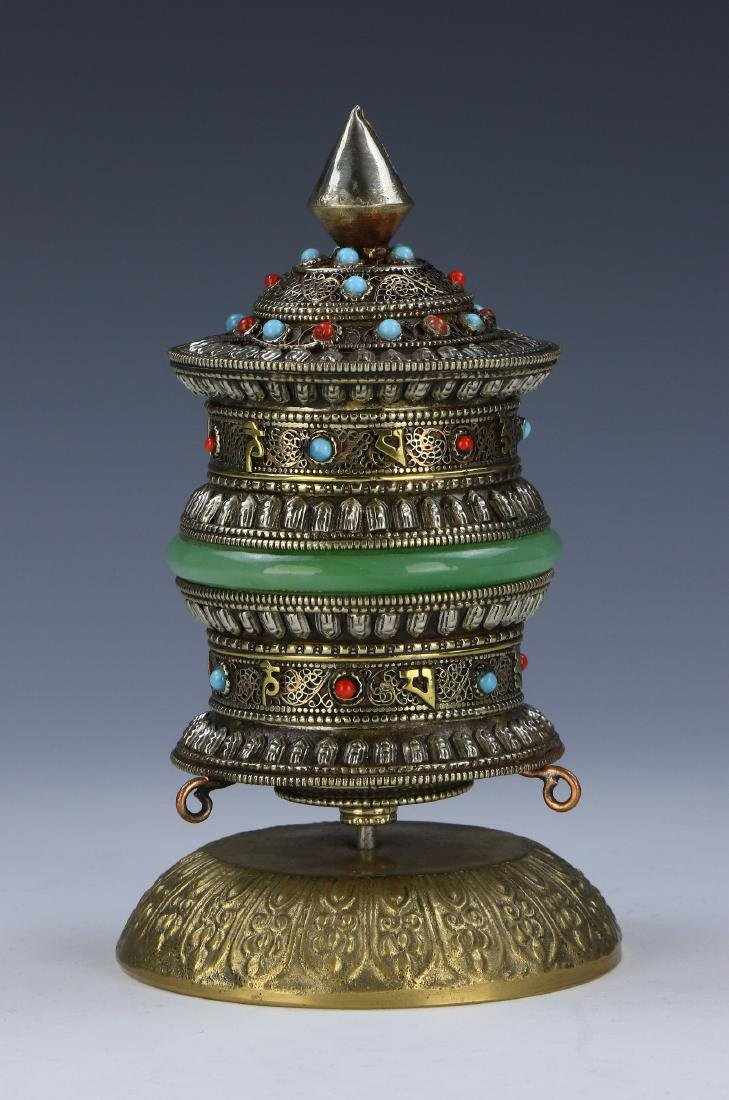 A TIBETAN PRAYER WHEEL