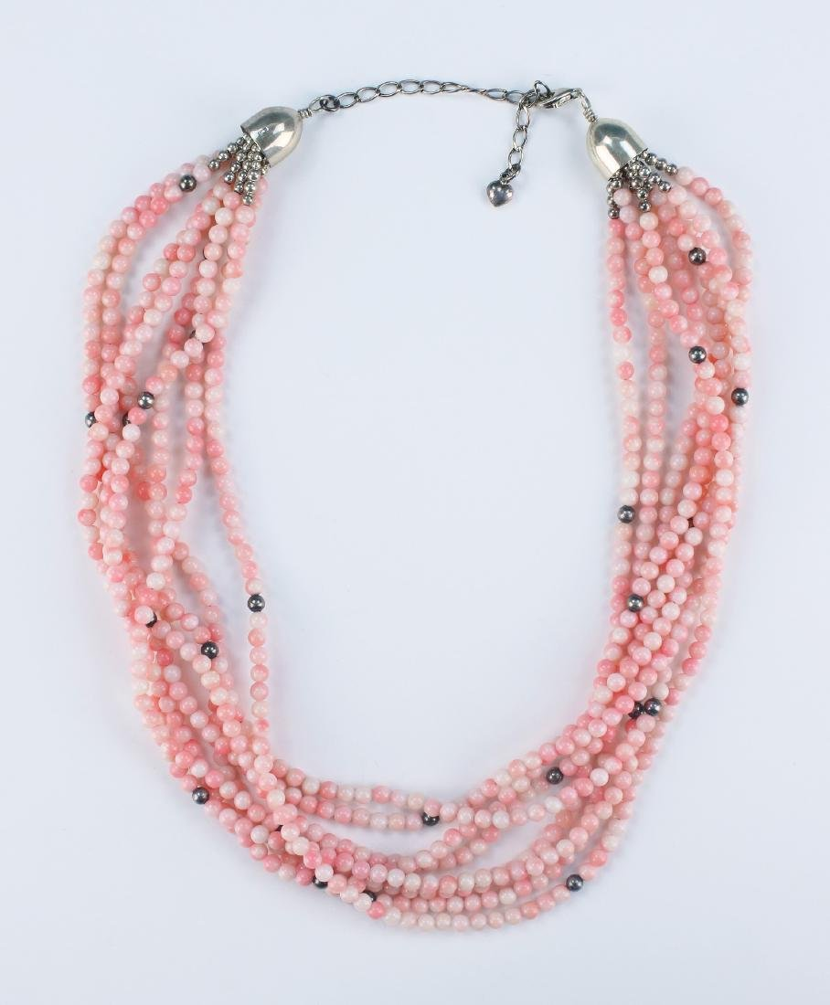 A CORAL EIGHT-STRAND BEADED NECKLACE