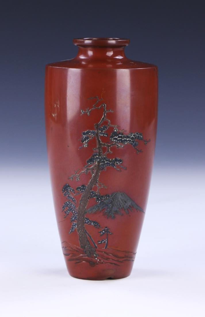 A JAPANESE CARVED MIXED METAL VASE