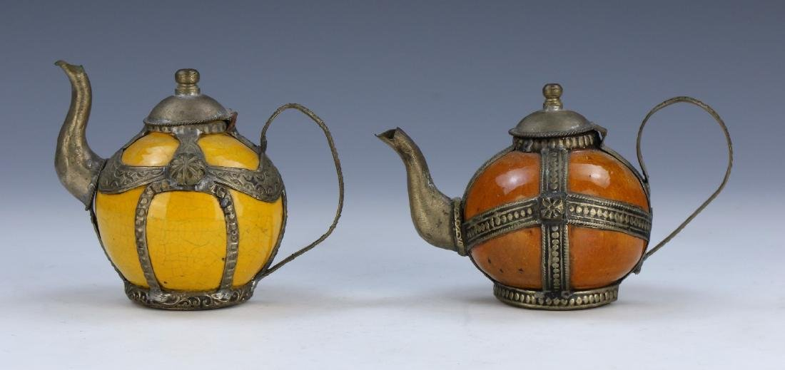 TWO (2) PORECELAIN TEAPOTS WITH COVERS