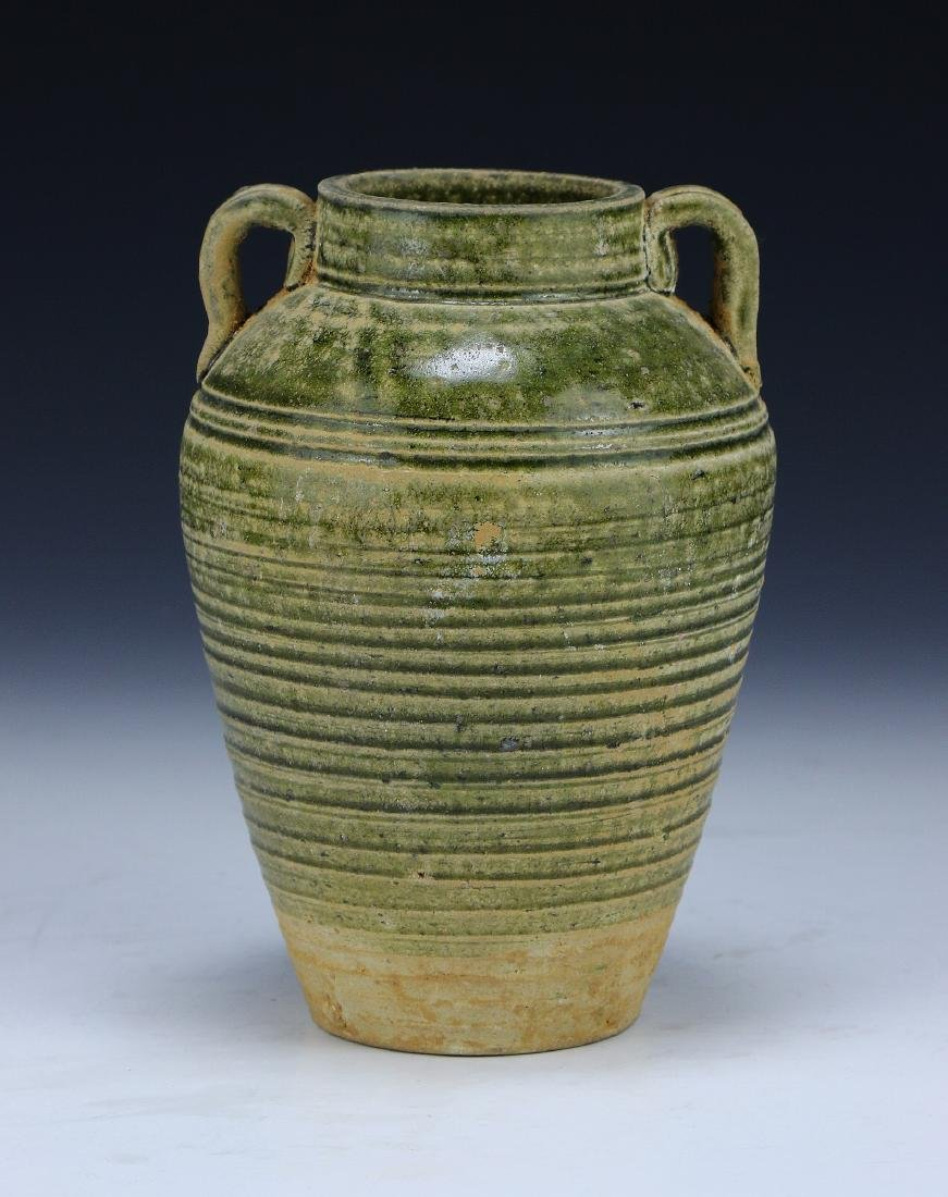 A CHINESE CELADON GLAZED TWO-HANDLE VASE