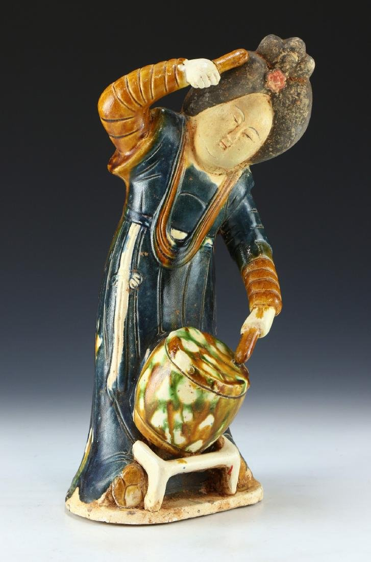 A CHINESE SANCAI GLAZED POTTERY FIGURE