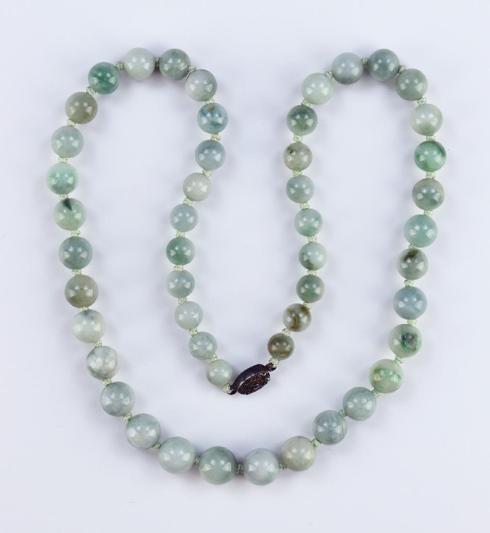 A CHINESE JADEITE BEADED NECKLACE