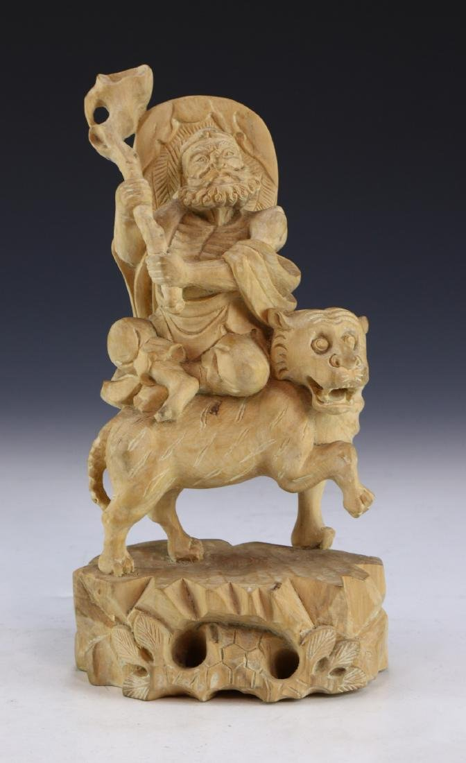 A CHINESE WOOD CARVED FIGURE GROUP