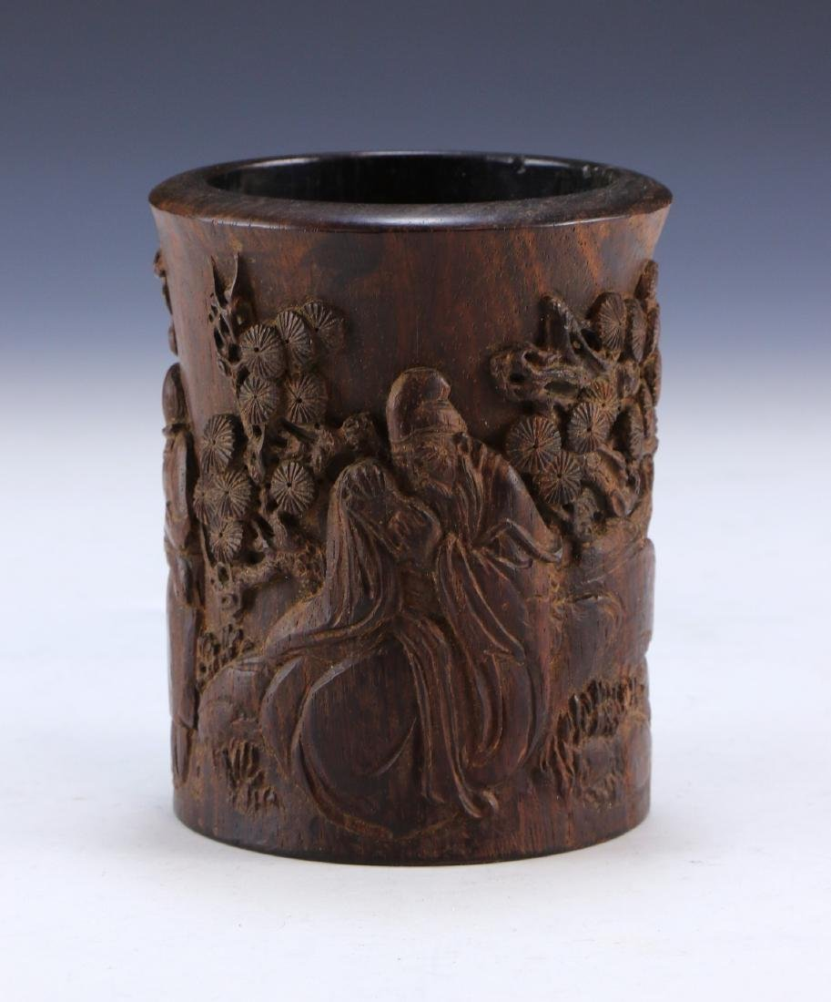 A CHINESE WOOD CARVED BRUSHPOT