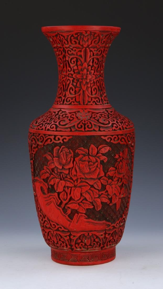 A CINNABAR LAQUER STYLE VASE