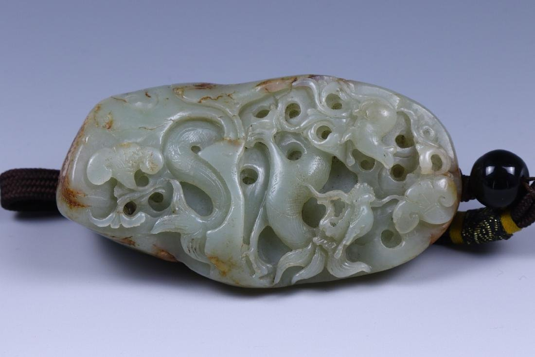 A BIG JADE CARVED PENDANT