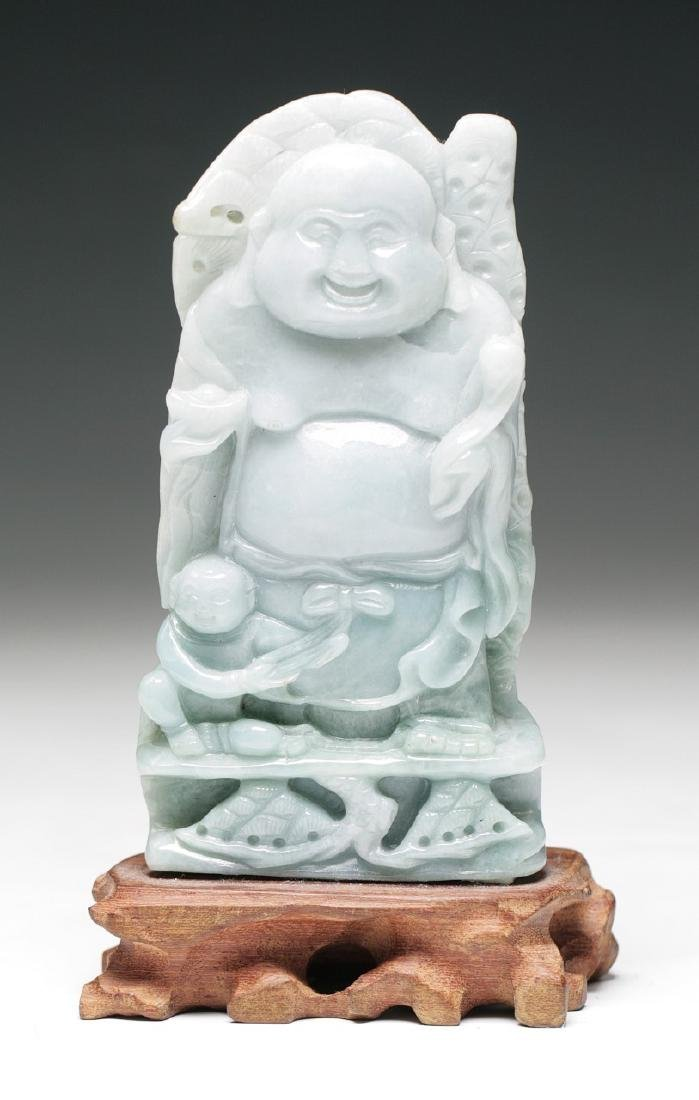 A CHINESE CARVED JADEITE BUDDHA