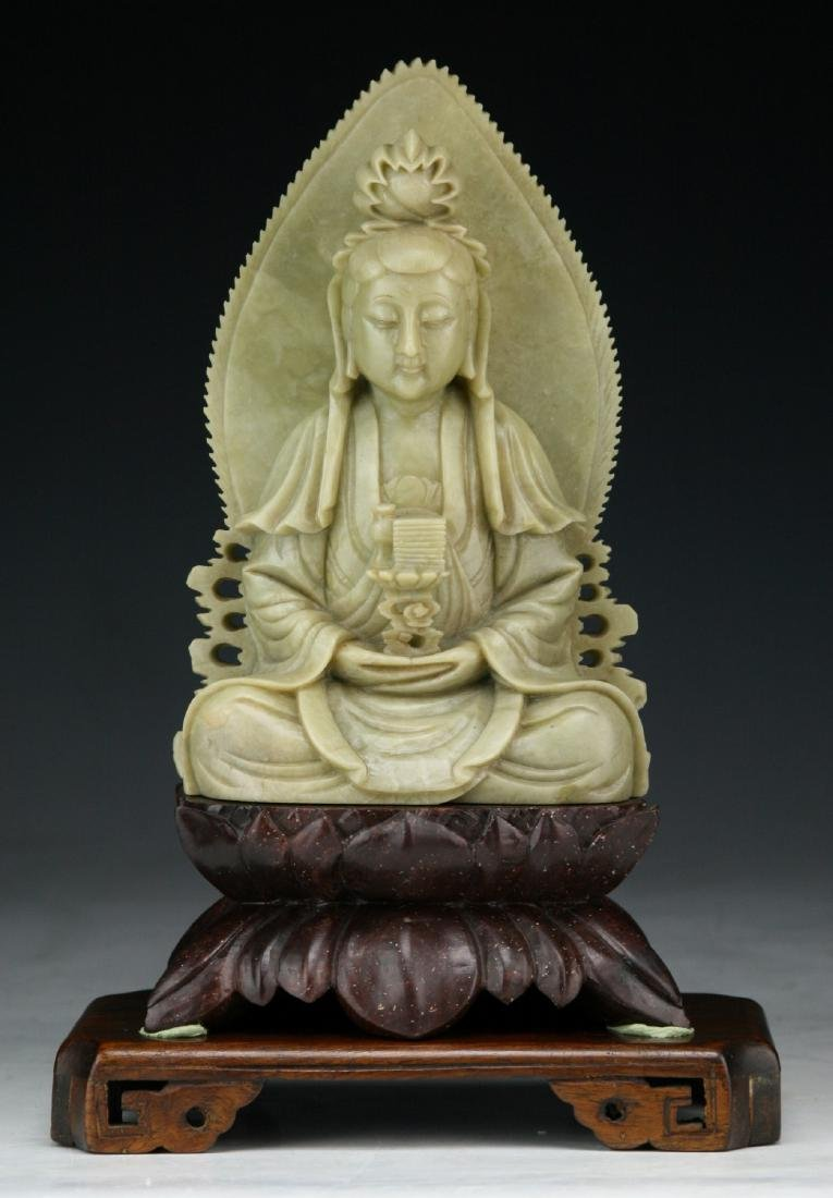 A CHINESE SOAPSTONE CARVED FIGURE OF GUANYIN
