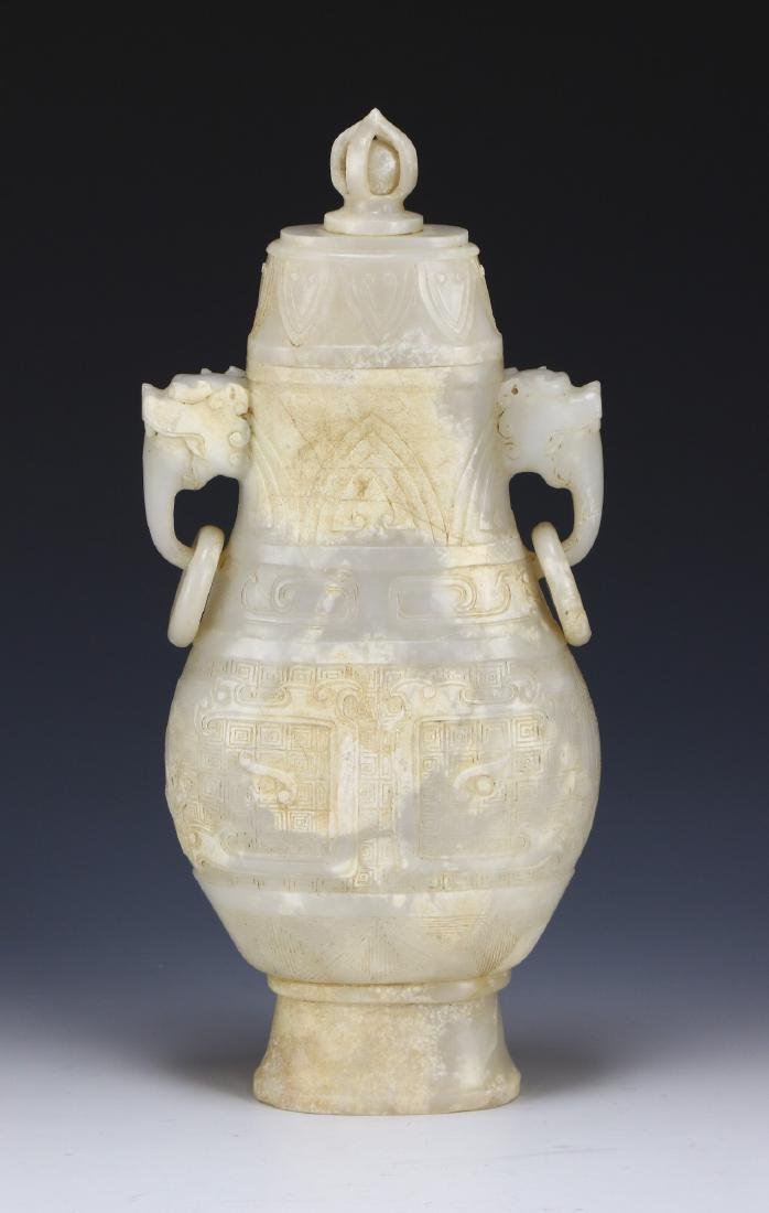 A CHINESE LIDDED JADE CARVED VASE