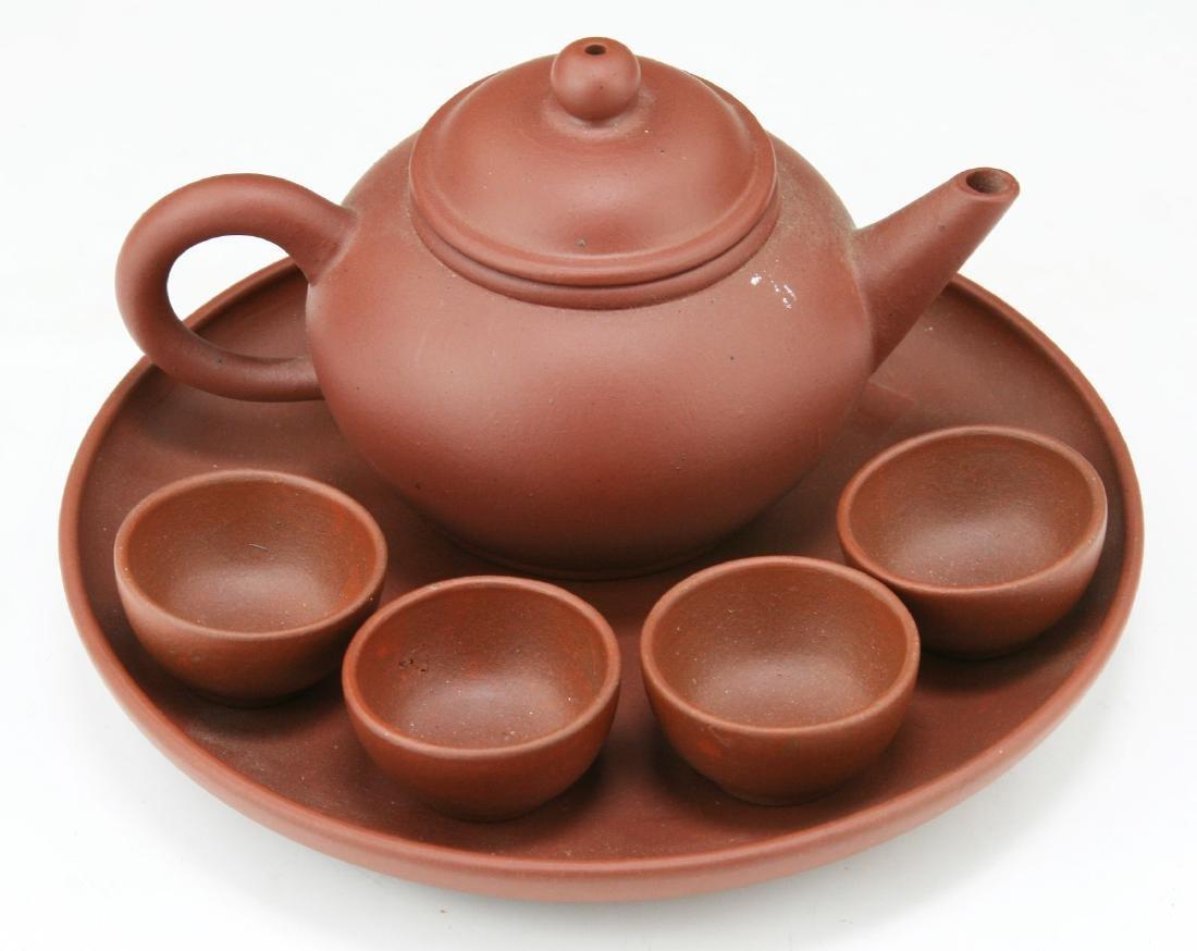A CHINESE YIXING ZISHA SIX (6) PIECE TEA SET