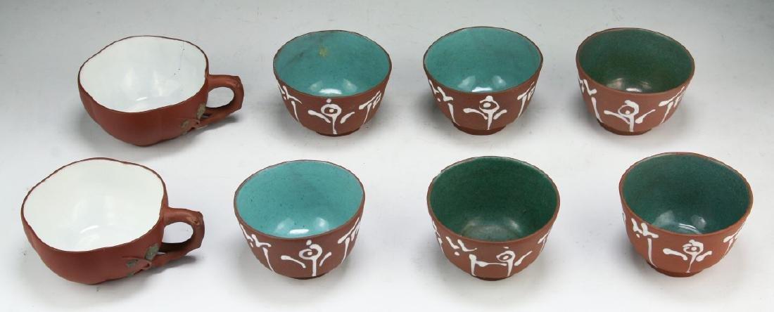 EIGHT (8) CHINESE ENAMELED ZISHA CUPS