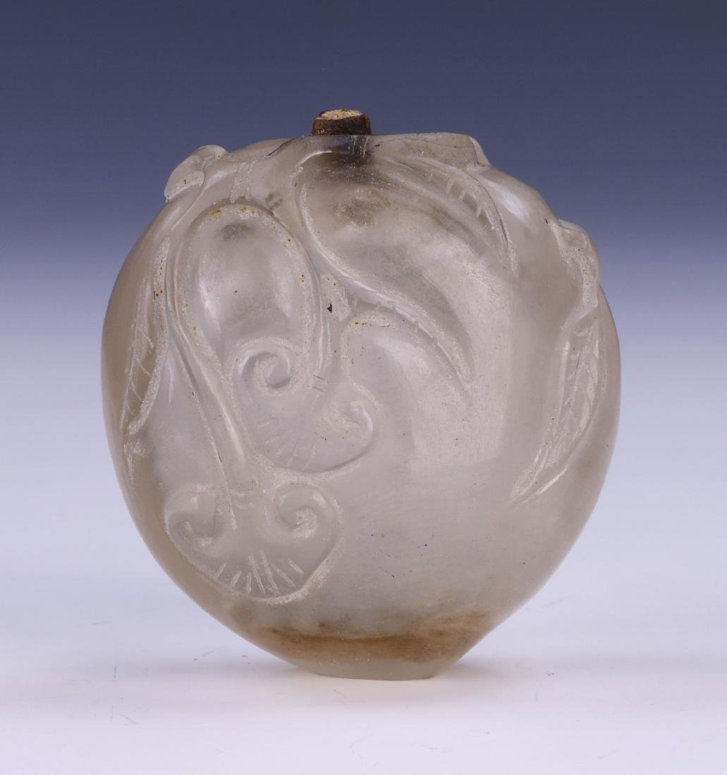 A CHINESE CRYSTAL CARVED SNUFF BOTTLE