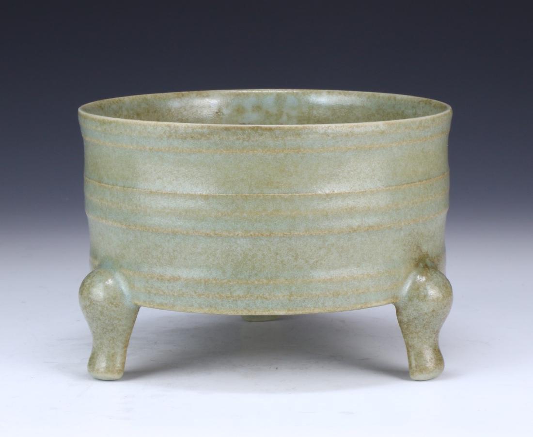 A CHINESE CELADON GLAZED TRI-POD XI CENSER