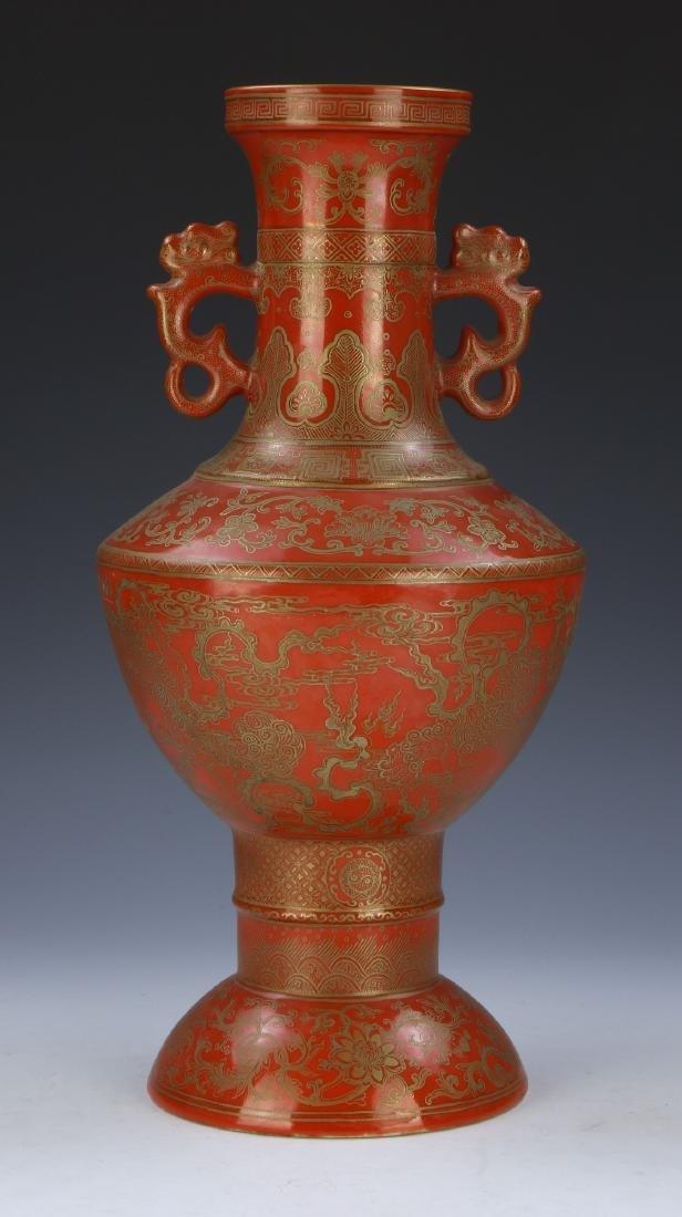 A CHINESE GILT & CORAL RED GLAZED PORCELAIN VASE