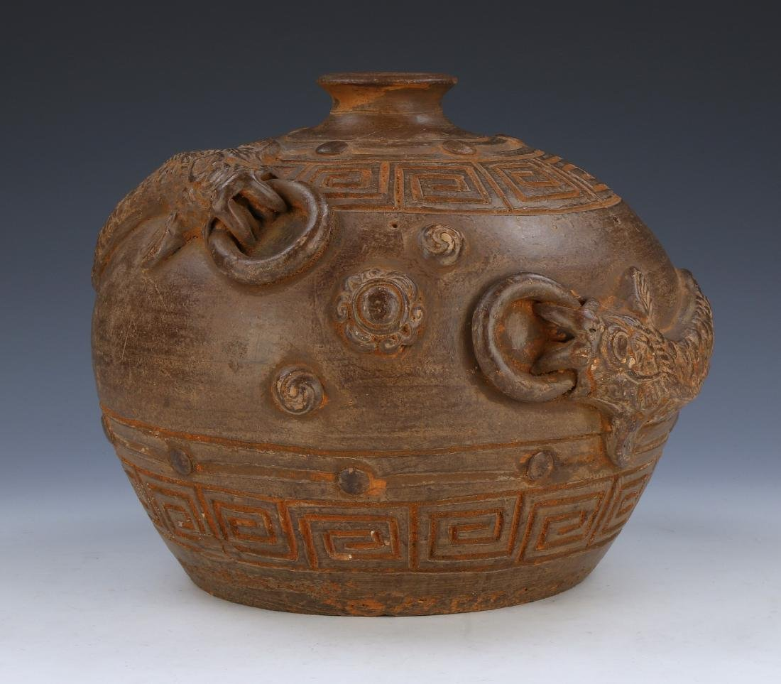 A CHINESE EARTHWARE JAR
