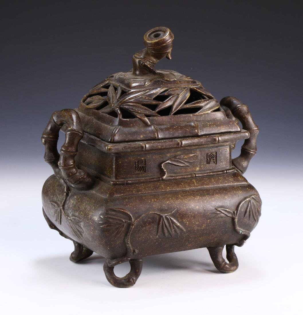 A CHINESE LIDDED BRONZE CENSER