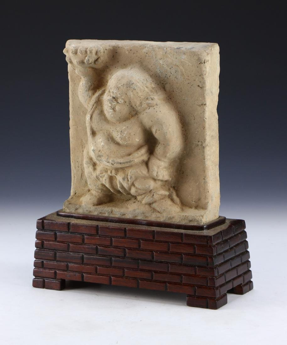 A GANDHARA-STYLE STONE CARVED BUDDHA