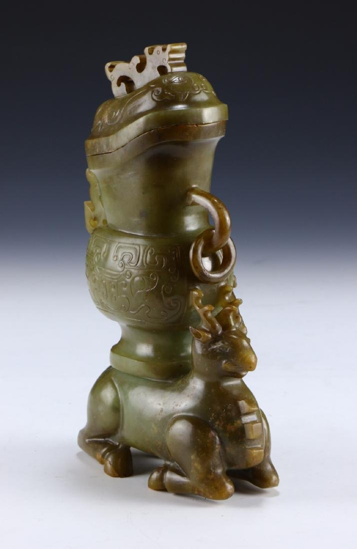 A CHINESE JADE CARVED LIDDED VASE