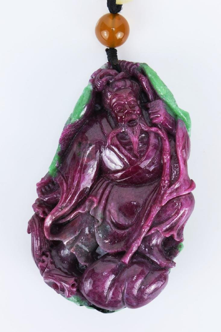 A RUBY MATRIX CARVED PENDANT