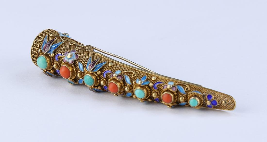A CHINESE JEWELED FILIGREE ON SILVER FINGER PROTECTOR