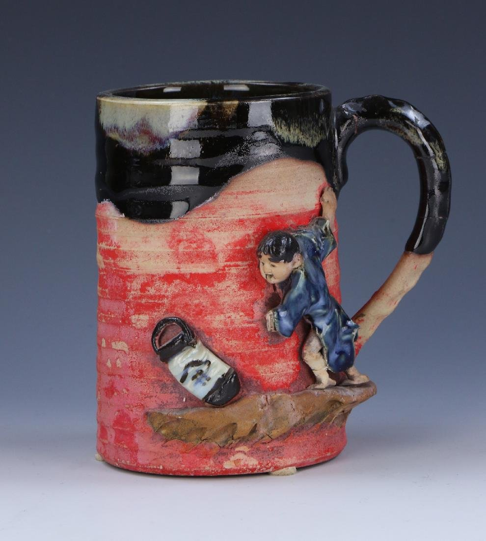 A JAPANESE SUMIDA GAWA PORCELAIN CUP