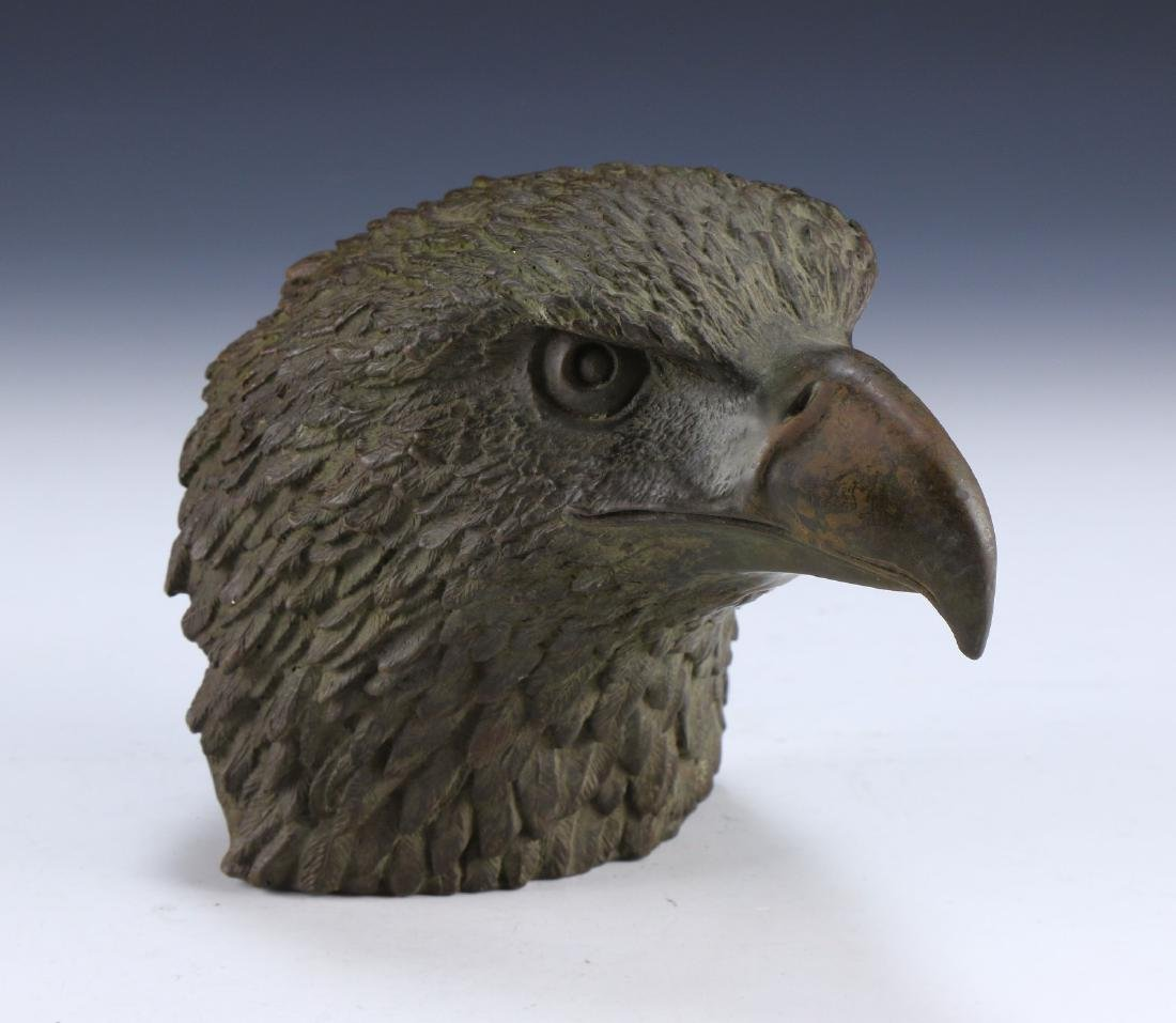 A CHINESE BRONZE EAGLE HEAD