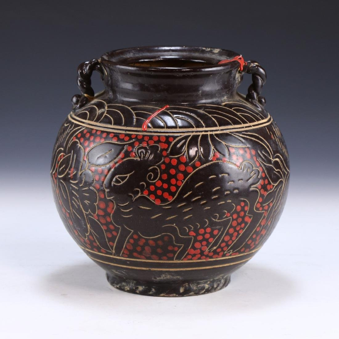 A CHINESE BLACK GLAZED PORCELAIN JAR