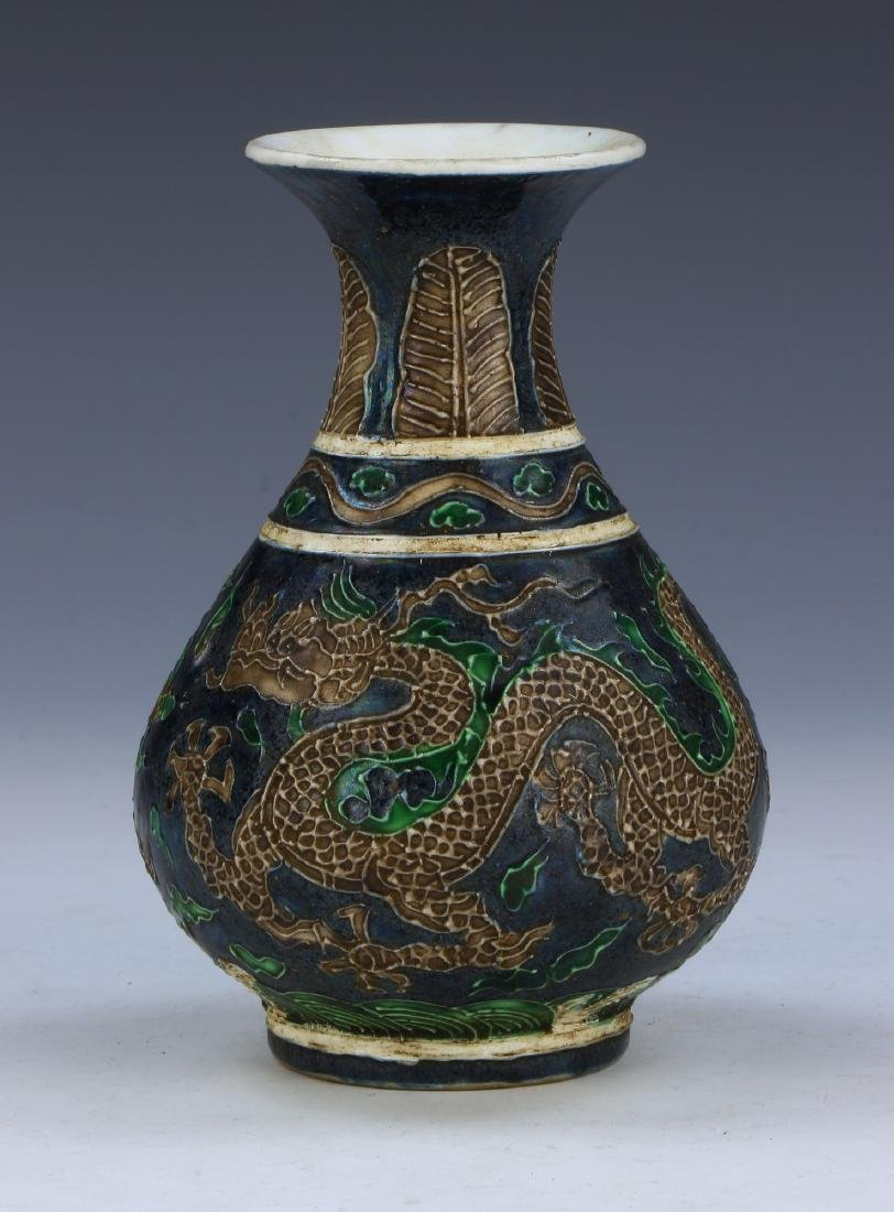 A CHINESE POLYCHROME PORCELAIN VASE