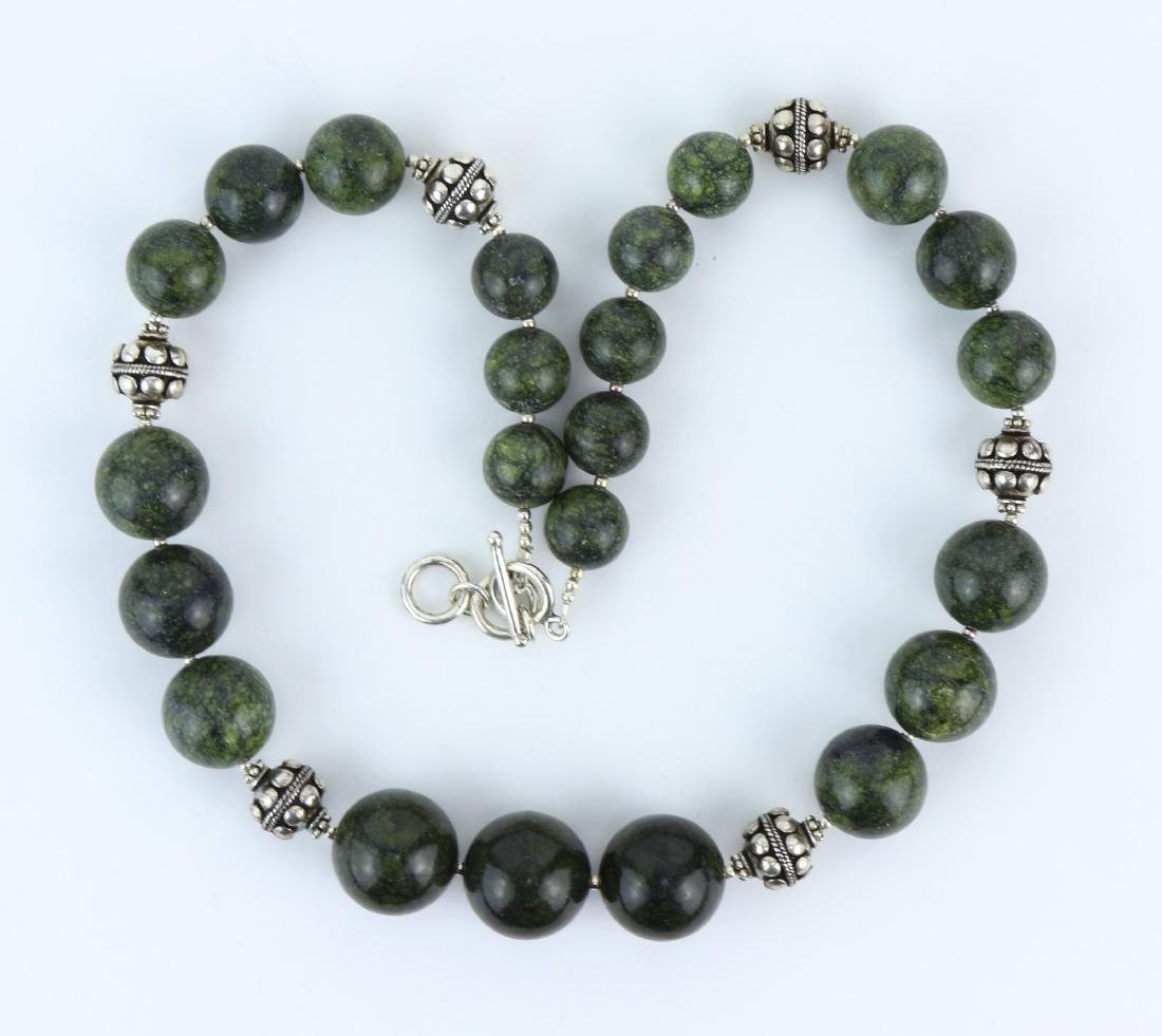 A SPINACH JADE & SILVER BEADED NECKLACE