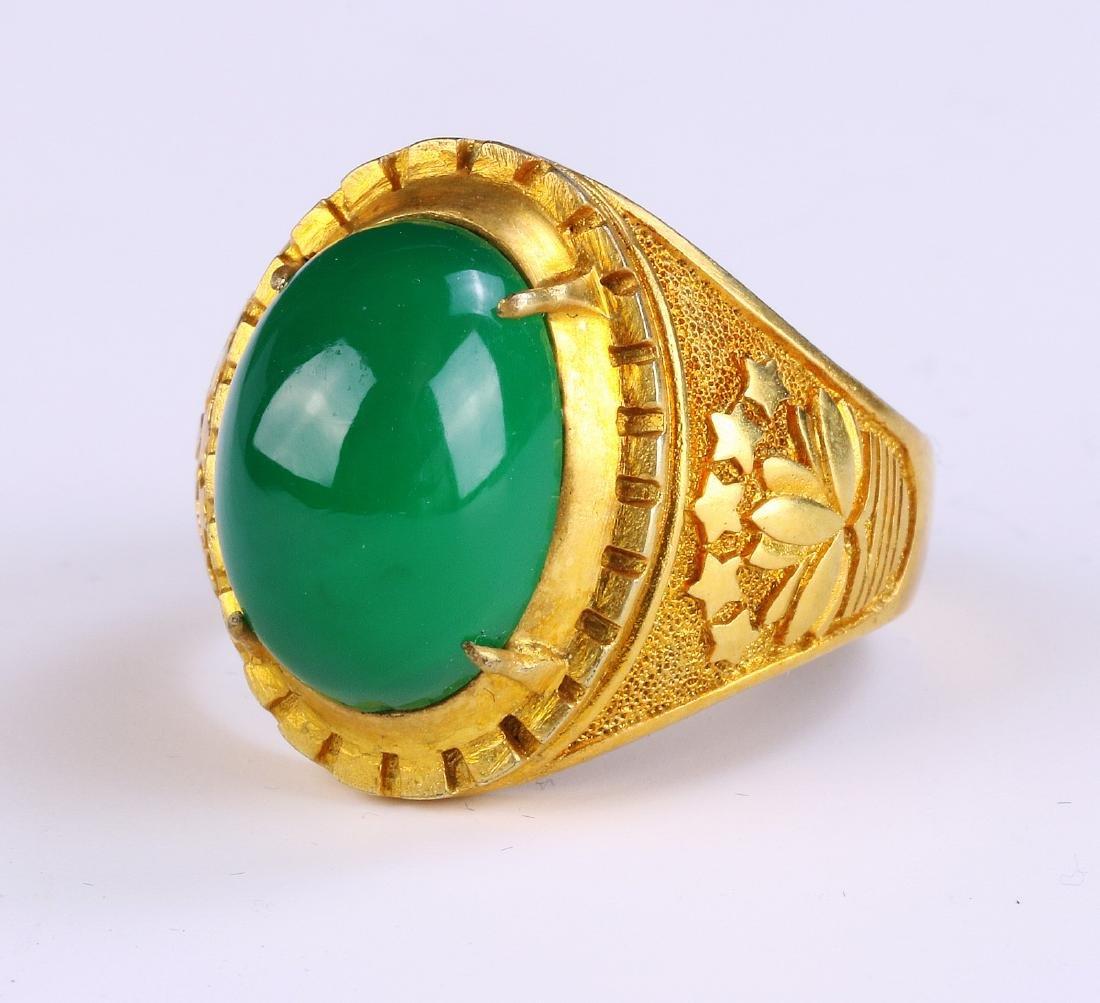 A GREEN & TRANSLUCENT JADE OR JADEITE MEN'S RING